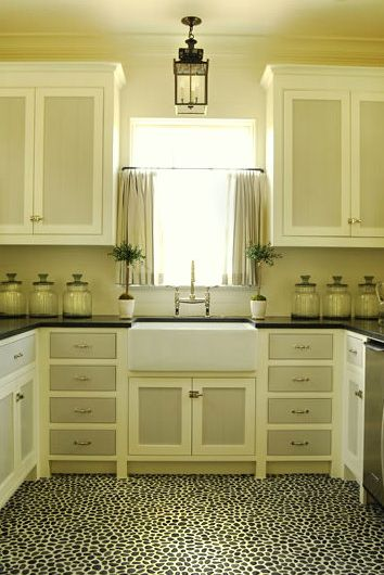 Two tone cabinets and pebble tile floor. Love it. I would mix in one more color maybe...like an orange or blue.