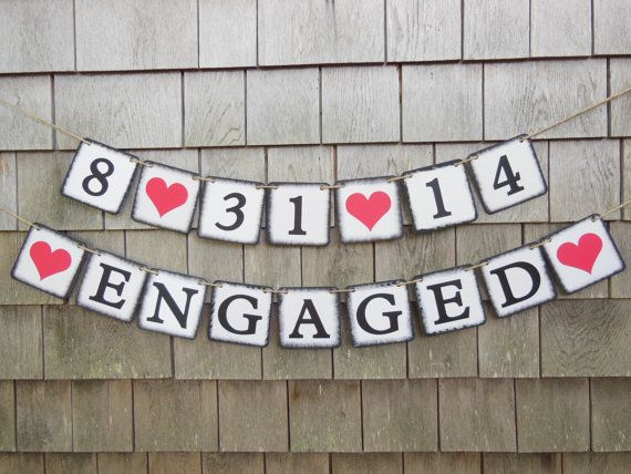 This 'Engaged banner and date banner would make a great addition to your surprise engagement party right after popping the questions! The