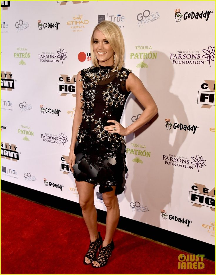 Carie Underwood at Muhammad Ali's 2016 Celebrity Fight Night XXII : Carrie looked pretty in a black embellished dress with matching shoes. Her hairstyle and makeup was fine. Nice!