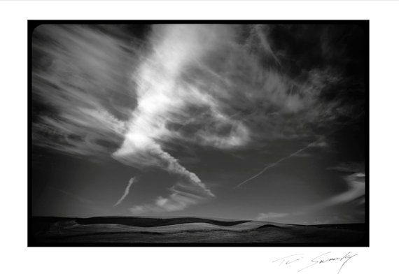 Dancing CloudsBlack and White Clouds running by SwankyPhotographic