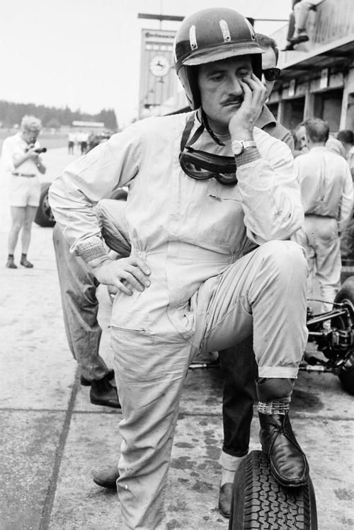 Graham Hill doing little to hide his disappointment after retiring from the 1963 German Grand Prix