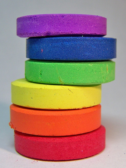 Cakes of paint from a child's paint set  •  by Sam Foster