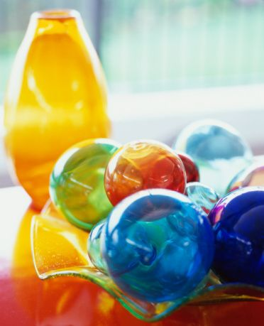 Feng Shui Color Balls --- In feng shui, colours are used according to the five elements feng shui theory. For example, blue colour is excellent feng shui in the North, green colour is great for the East, while red colour is best in the South.  (Photo Credit: Lisa Romerein / Getty Images)  Each color is an expression of one of the five feng shui elements: Fire, Earth, Metal, Water, and Wood. These elements are used in specific areas according to the feng shui energy map of your space, or…