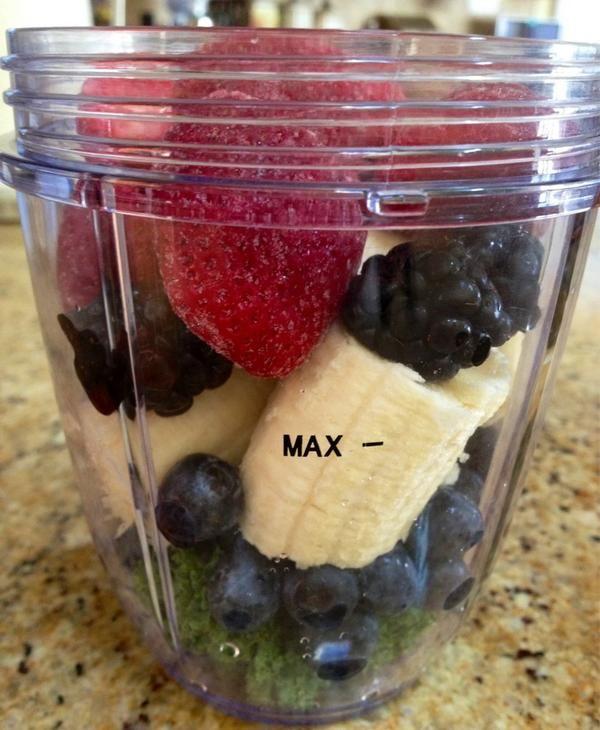 Making a #nutribullet smoothie! kale blueberries strawberries bananas healthy delicious nutriblast
