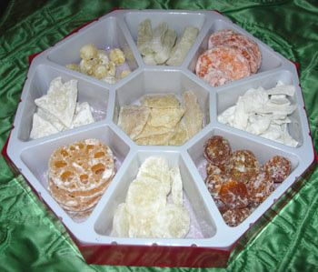 BEFORE BUY Tray of Togetherness candied melon (symbolizing good health) red melon seed (joy) lychee nut (strong family) kumquats (prosperity) coconut (unity) peanuts (longevity) longan (many good sons) lotus seeds (fertility)