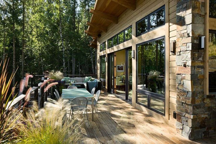 Compact yet stunning modern-rustic cabin perched over Swan Lake