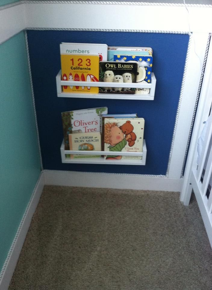 Oliver's Nautical Nursery..... with $4 ikea spice racks as book shelves : )