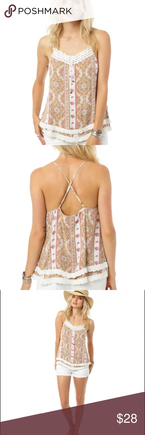 "O'NEILL KASSIA TOP Pack, board and away! Fly off to good vibes and wild summer nights in the O'Neill women's Kassia Top.  Spaghetti strap tank top Losse, easy fit Tassel embellished rope tie detail Crochet neckline and tiered hemline detail Allover muted print 17"" in length 100% Viscose O'Neill Tops"