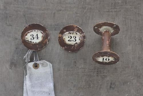 Set of three unique metal wall hooks from the Inspired Home Collection. Distressed ivory metal and rust finish.