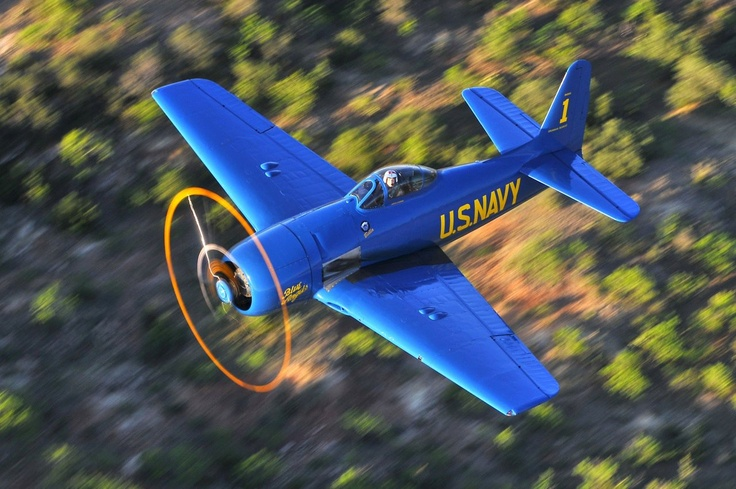 """Blue Angel Bear ... On 25 August 1946, the Blue Angels transitioned to the Grumman F8F-1 Bearcat and introduced the famous """"diamond"""" formation."""