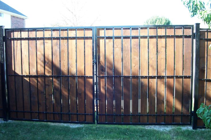 Estate fence wood iron privacy panel fence pictures for How to build a short fence