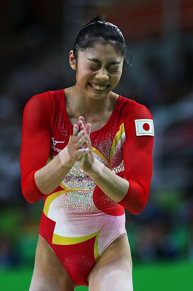 Yuki Uchiyama of Japan reacts after competing on the balance beam during Women's qualification for Artistic Gymnastics on Day 2…