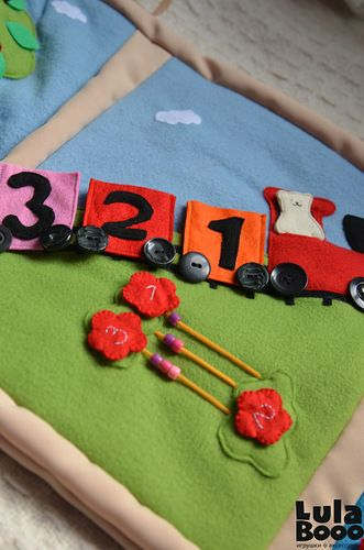 Crib bumper with game developing elements - the train
