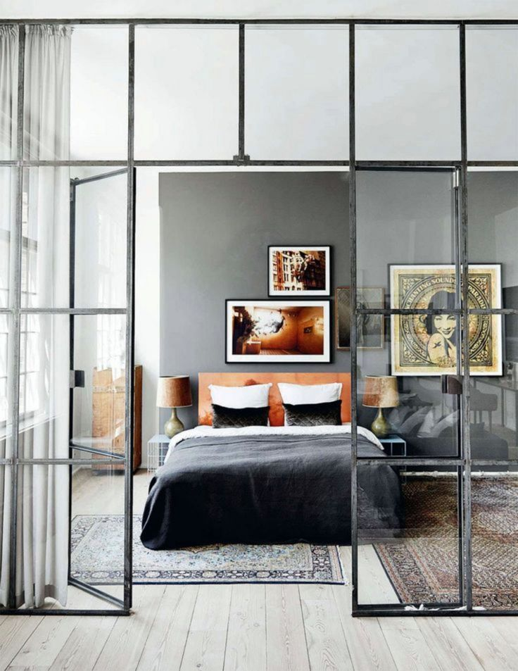 Tones of grey with orange accents on headboard and wall photos