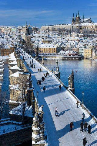 snow-covered Charles Bridge - Prague, Czech Republic