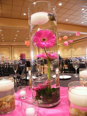 Submerged Gerbera Daisy Centerpiece with Floating Candle  this is what mine is going to look like with a red or yellow accented flower instead of pink