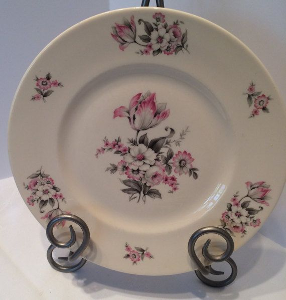 Very beautiful Aberdeen China dinner plates in the Moss Rose pattern. Pale cream background with a soft pink and grey floral motif. The pattern was created in the 1930s. These beautiful plates go so well with todays popular gray tableware...for a mix and match vintage look. Goes perfect