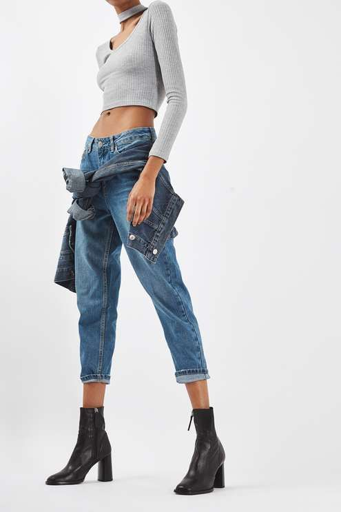 Crafted from pure cotton, our MOTO Mom jeans come in an authentic rigid-look denim. Cut with a high-waist and a tapered leg, they come with multiple pockets and classic trims. Wear them folded at the cuffs to keep them looking cool. #Topshop