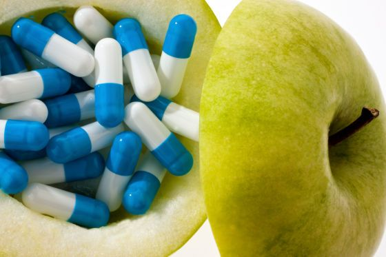 image #7772t014 Apple with tablets capsules Representative photo for vitamin tablets #gelule #vitamine #concept