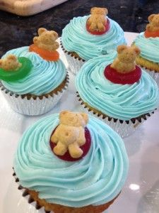 """Pool Party Cupcakes: So easy to make and super cute! Add cookie crumbs (for """"sand""""), a bright gumball (for a beach ball)  and a cocktail umbrella for a beach look."""