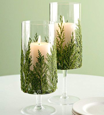 We'll be adding bits of evergreen to our candle containers this holiday. How pretty! More Christmas candle displays: http://www.bhg.com/christmas/indoor-decorating/christmas-candle-displays/?socsrc=bhgpin102512evergreencandle