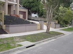 Front Fence, Retaining Wall & Water Tank ALL in one.