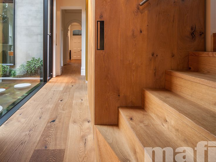 A timeless masterpiece by Nicholas Murray Architects. Staircase, wall and hallway floors in mafi Oak Country Brushed Natural Oil floorboards.