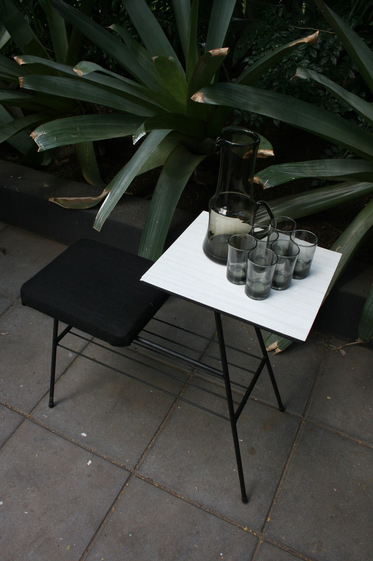 Retro telephone table, with black burlap upholstery and laminate table shown with handblown smoked jug and glasses.