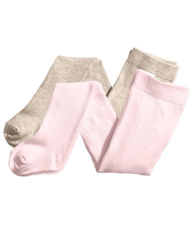 Fine-knit tights in a soft cotton blend with an elasticized waistband.