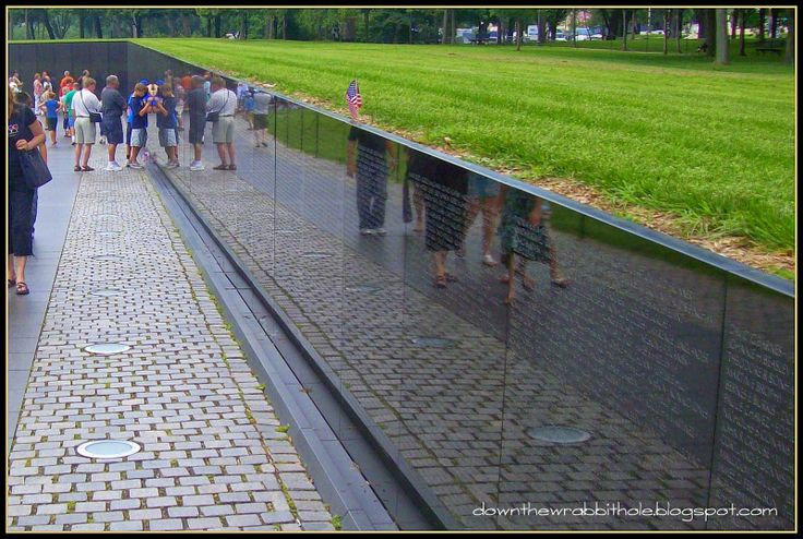 "Read all the names on the Vietnam Veterans Memorial Wall in Washington DC. Find out more at ""Down the Wrabbit Hole - The Travel Bucket List"". Click the image for the blog post."
