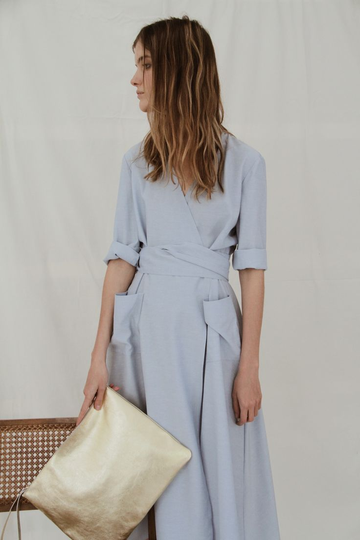 Wrap belted dress with 2 pockets on the hips.  Size 38-Length 112cm Shoulder to shoulder 36,5cm Armpit to armpit 42cm  Size 40-Length 113cm Shoulder to shoulder 38,5cm Armpit to armpit 43cm  Light blue/ Soft pink / Black  Cotton fabric  Made in Spain