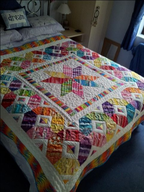 "Scrap happy quilt by Izy (UK) posted at Quilting Board. ""All bright scraps, even the white is an upcycled white sheet!"""