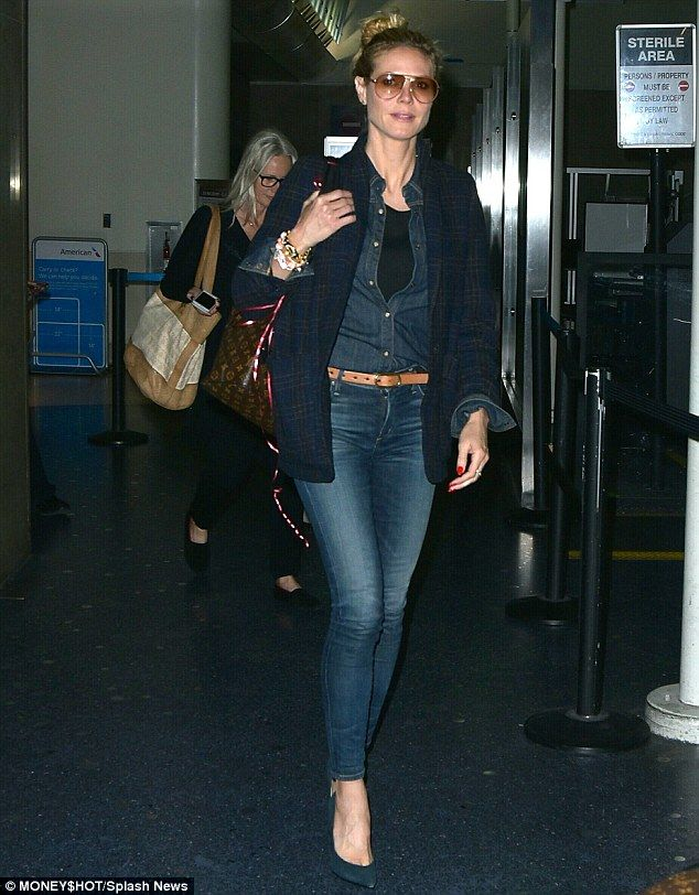 Jean genie: Heidi Klum wore double denim as she arrived at Los Angeles International Airpo...