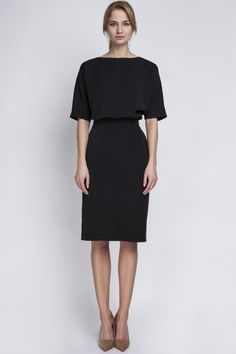 Classic pencil dress in black with fitted waistline and elbow-length sleeves. Can be worn with or without a belt. This conservative dress is Knee-length and has a back zipper closure. Pair it with som