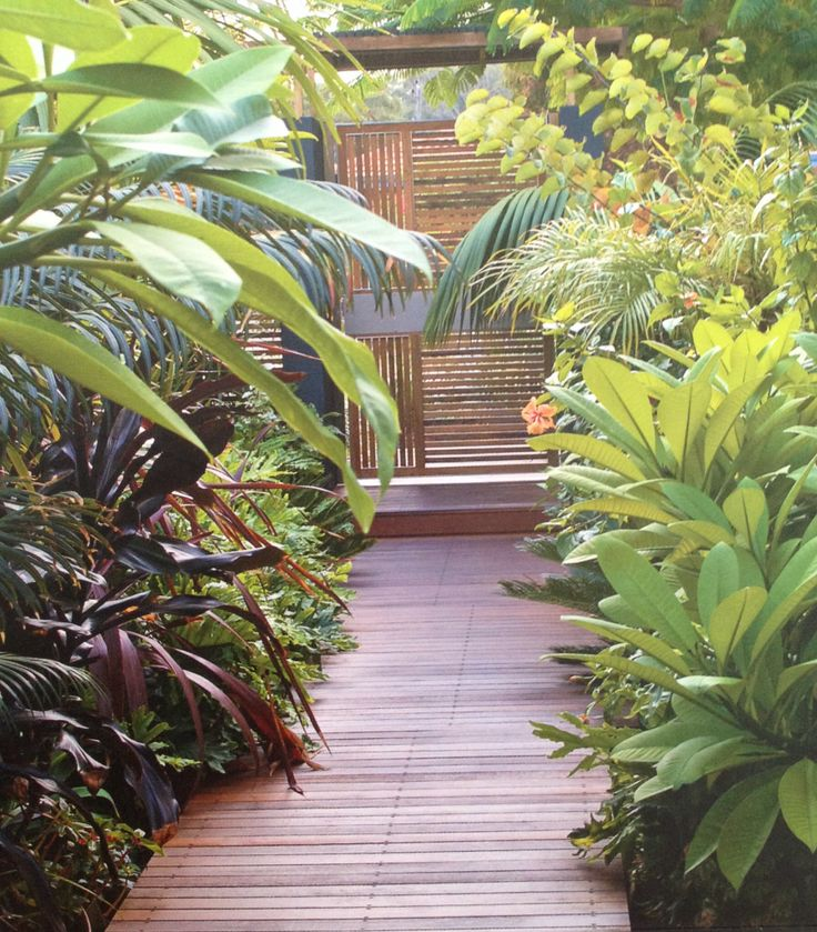 Possible idea for entry leading to front door. A floating board walk with garden bed on one side. This photo from Janine Mendel/Cultivart.