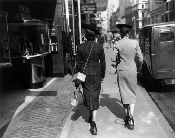 September 1939: Two elegant women shoppers in Bond street, London, carry gas masks in cardboard boxes slung over their shoulders. (Photo by Davis/Getty Images) #london #war #East_End
