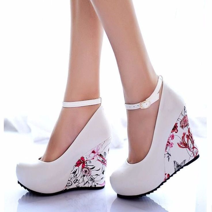 Have a greater heights using this floral wedge shoes. This features buckles strap that fasten securely on the ankles, floral print heel, round toe. Crafted from PU, soft leather, rubber, EVA materials