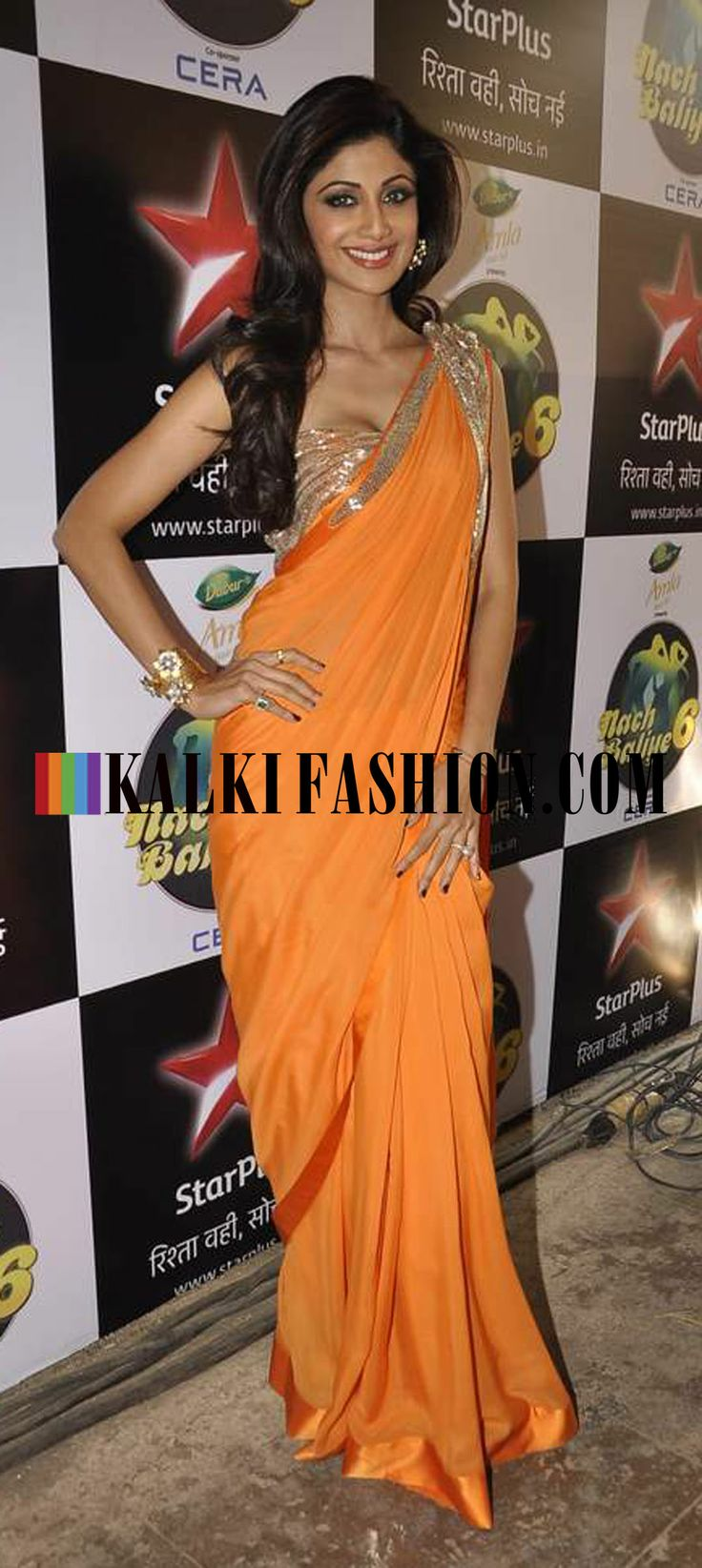 http://www.kalkifashion.com/ Shilpa Shetty poses in an orange Gaurav Gupta saree on the set of Nach Baliye