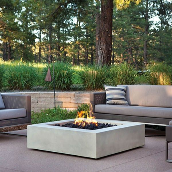 Define your outdoor space with the clean design of a Real Flame Mezzo Square Fire Pit Table. Cast from a high performance, lightweight fiber-concrete with an outdoor safe finish, this fire table comes complete with lava rock filler and a weatherproof cove
