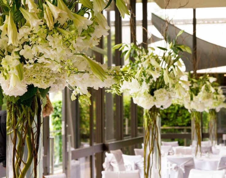 Decor It Events tall floral centerpieces filled with hydrangea and lillies #centerpieces #weddings #floral #hydrangea