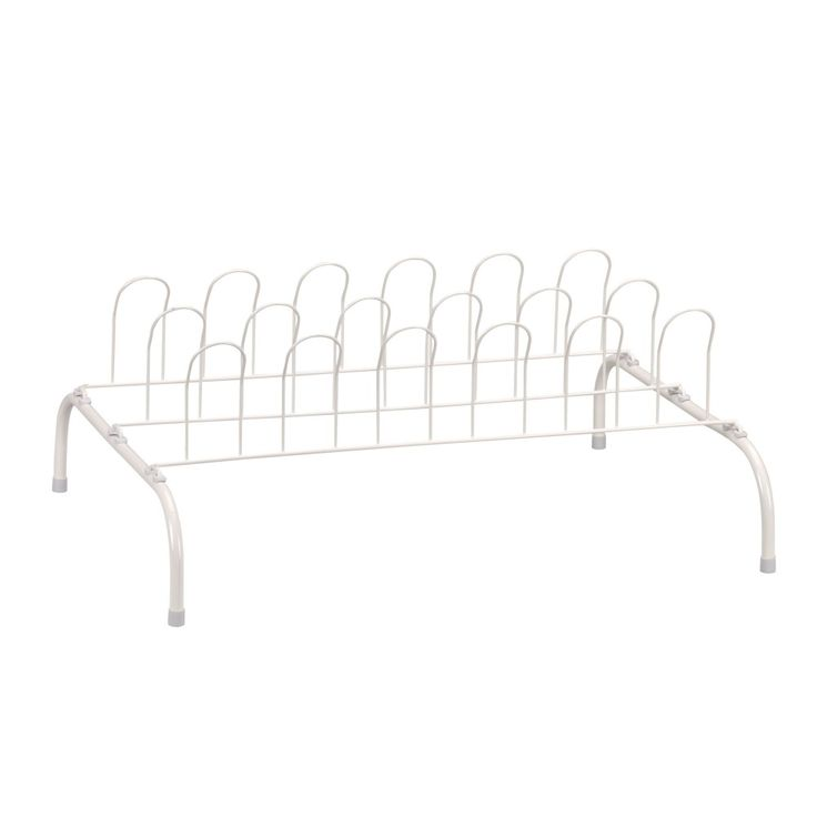 9-Pair Wire Shoe Rack, White. Household Essentials Wire Shoe Rack is a traditional shoe rack that holds up to 9 pairs of shoes. This wire frame shoe rack has 3 rows of 6 vertical wire arches. Each arch fits inside the toe of one shoe. Because shoes are held vertically, the rack takes up very little space. It sits low to the floor, too, so it's a perfect shoe rack to keep under hanging dresses or coats. This traditional shoe rack is 9.1 inches high, 22 inches wide, and 16...