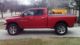 """Red 4th Gen Ram 1500 with 4"""" RCX Lift on 35"""" tires."""