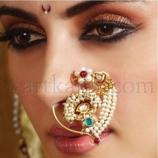 Fancy design in nath . . Westerners will catch up with the larger nose-jewelry soon.