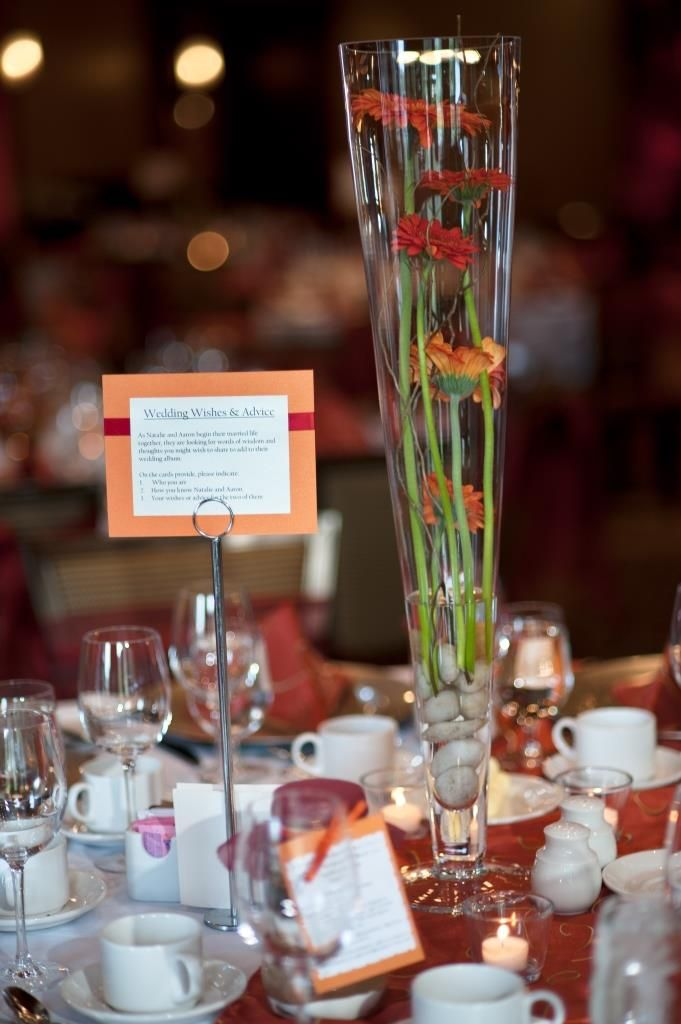 Tall Centerpiece In Pilsner Vase Burnt Orange And Cranberry Red Gerbera Daisies Canmore Wedding Planner Decorator Photo Courtesy Of Snap Weddings