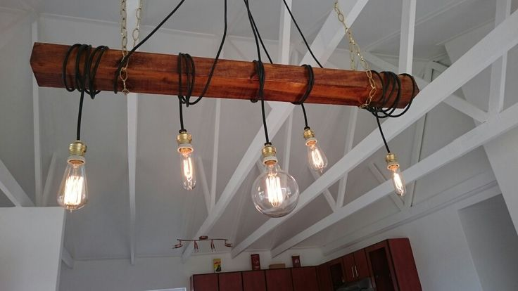 Lounge fitting  Globes and wire from EP Electro in Uitenhage. Beam is a stained pine, off cut from Buco. Decorative chains from Builders Warehouse. Total cost about R900.