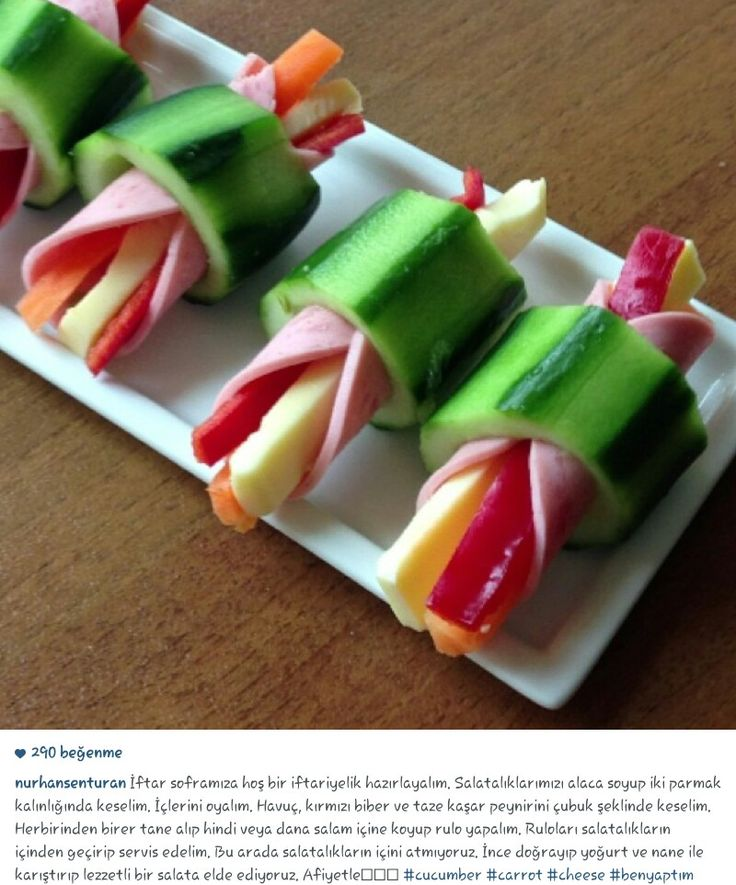 Red bell pepper, carrot,cheese, ham,stuffed inside a cucumber
