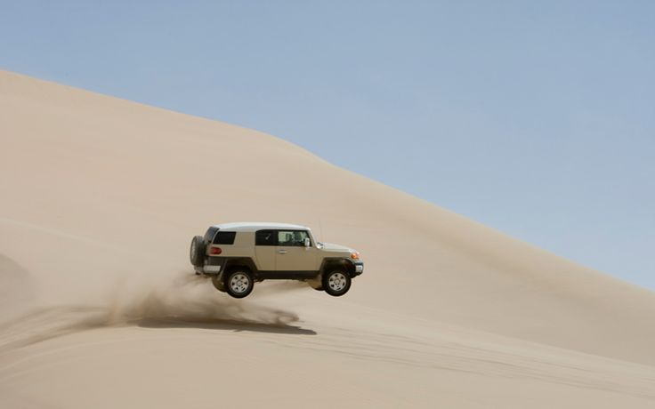 Grandma is back, but this time jumping her Toyota FJ Cruiser at the sand dunes