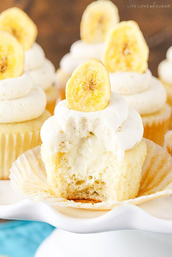 Banana Cream Pie Cupcakes - Banana cupcakes, cream pie filling and an amazing banana frosting with a special ingredient! Seriously to die for!