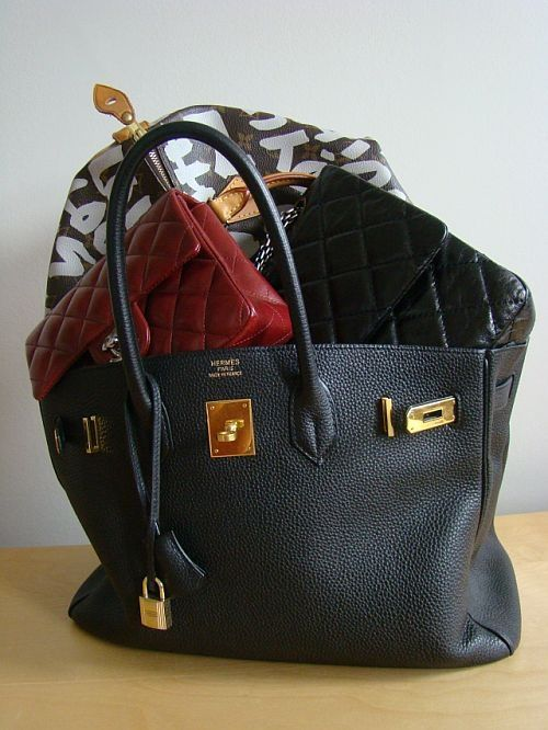 black hermes birkin stuffed with red and black quilted chanel bags and a graffiti edition louis vuitton.