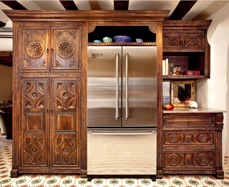 Spanish Colonial   Carved Custom Cabinets in Santa Fe, New Mexico ~  portfolio picture of La Flora Blanca kitchen. I love how this combination of cabinet door styles turned out! Mediterranean door styles. This panel would be fabulous as an interior door choice in a Spanish Revival home.